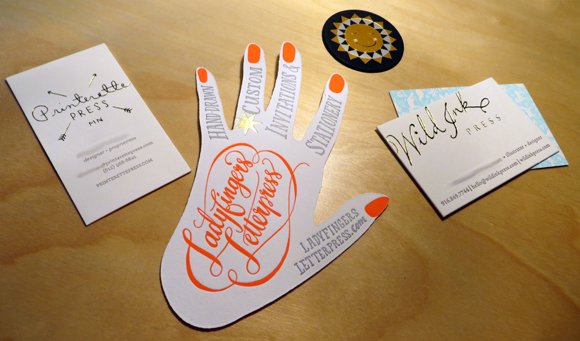 Miscellaneous gold-accented business cards and promo pieces