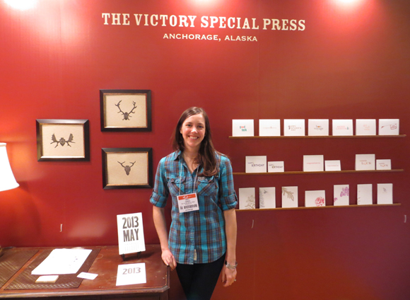 The Victory Special Press booth with Emily Harris