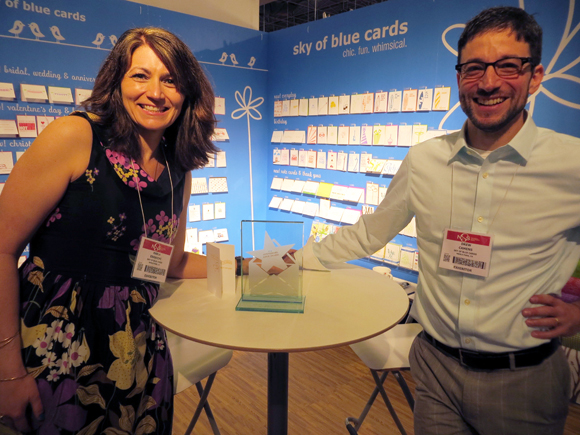 Karla Ebrahimi and Drew Camens in the Sky of Blue Cards booth